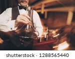 close up. sommelier with bow... | Shutterstock . vector #1288565440