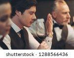 young handsome sommelier man... | Shutterstock . vector #1288566436