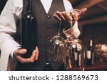 close up. sommelier in bow tie... | Shutterstock . vector #1288569673