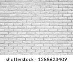 white brick wall texture...   Shutterstock . vector #1288623409