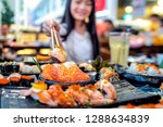 asian lady eat a salmon fish... | Shutterstock . vector #1288634839
