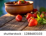 ripe red strawberries with... | Shutterstock . vector #1288683103