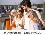three friends walk happy...   Shutterstock . vector #1288699120
