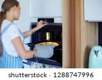 happy young woman cooking pizza ... | Shutterstock . vector #1288747996
