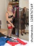 woman in underwear selecting... | Shutterstock . vector #1288767169