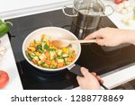 fresh vegetables fried in a pan.... | Shutterstock . vector #1288778869