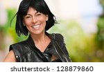 happy mature woman with short... | Shutterstock . vector #128879860