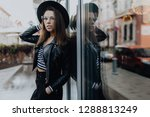 young fashion woman walking on... | Shutterstock . vector #1288813249