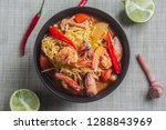 Stock photo top view of mama tom yum shrimp with seafood has a spicy and sour taste that is popular in thailand 1288843969