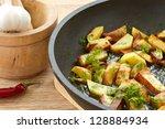 Potatoes Fried In Oil In A...