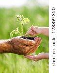 child and senior man holding... | Shutterstock . vector #128892350