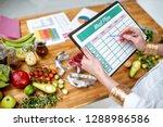 dietitian writing a diet plan ... | Shutterstock . vector #1288986586