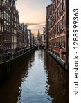 amsterdam canal view bordered... | Shutterstock . vector #1288999363