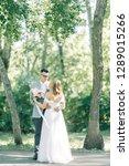 wedding couple in the park... | Shutterstock . vector #1289015266