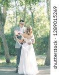 wedding couple in the park... | Shutterstock . vector #1289015269