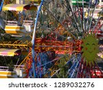 Sun image on a ferris wheel, with blurred view of cabins in the foreground (reverse bokeh)