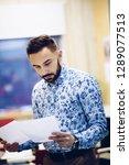 businessman reading documents... | Shutterstock . vector #1289077513