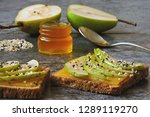 bran toasts with pear and honey.... | Shutterstock . vector #1289119270
