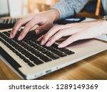 women typing keyboard laptop on ... | Shutterstock . vector #1289149369