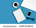 workplace with laptop and blank ... | Shutterstock . vector #1289194843
