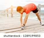 young man doing exercise at the ...   Shutterstock . vector #1289199853