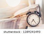 vintage alarm clock on the... | Shutterstock . vector #1289241493