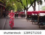 chinese lady in red cheongsam... | Shutterstock . vector #1289271310