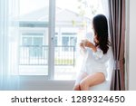 asian woman drinking coffee in... | Shutterstock . vector #1289324650