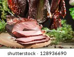 Closeup of freshly smoked ham in a rural smokehouse - stock photo