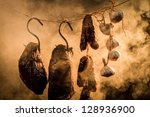 Ham, sausage and garlic in a smokehouse - stock photo