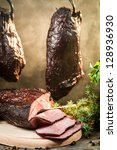 Closeup of smoked ham in a traditional rural way - stock photo