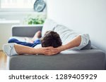 young man relaxing on sofa... | Shutterstock . vector #1289405929