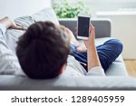 young man using smartphone... | Shutterstock . vector #1289405959