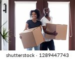 excited black couple carry... | Shutterstock . vector #1289447743