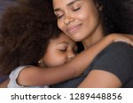 loving single black mother hugs ... | Shutterstock . vector #1289448856