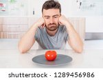 sad man diet ready to eat salad ... | Shutterstock . vector #1289456986