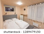 bed with white blanket and... | Shutterstock . vector #1289479150