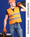 man in helmet  hard hat holds... | Shutterstock . vector #1289636296