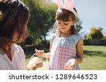 little girl wearing rabbit ear... | Shutterstock . vector #1289646523