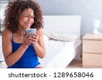 happy young black woman... | Shutterstock . vector #1289658046