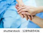 holding touching hands asian... | Shutterstock . vector #1289685436