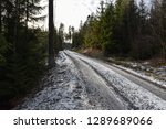 winding frosty gravel road... | Shutterstock . vector #1289689066