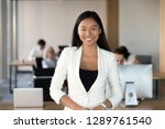 smiling young asian business... | Shutterstock . vector #1289761540