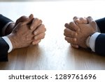 Small photo of Clasped hands of two business men negotiators opponents opposite on table as politicians dialogue debate, applicant hr job interview, negotiating competitors, rivals confrontation challenge concept