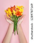 hands and spring flowers are on ... | Shutterstock . vector #1289787169