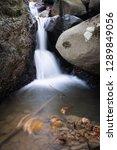 beautiful forest waterfall... | Shutterstock . vector #1289849056