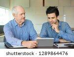 senior colleague describing... | Shutterstock . vector #1289864476