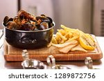 mussels in saucepan and fries....   Shutterstock . vector #1289872756