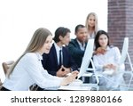 business team discussing with... | Shutterstock . vector #1289880166