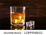 glass of whiskey with ice cubes ... | Shutterstock . vector #1289908810